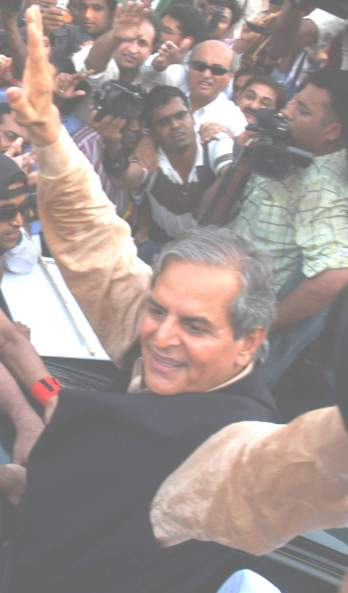 Makhdoom Javed Hashmi waving hand on his release