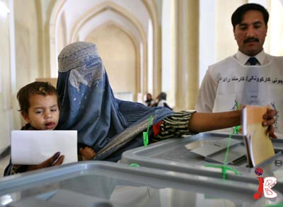 August 20: A veil clad Afghan woman casts her vote at a poling station in Kabul during the general elections of Afghanistan.