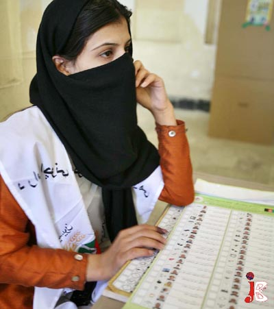 August 20: An afghan girl waiting for voters at a poll station at Afghanistan.