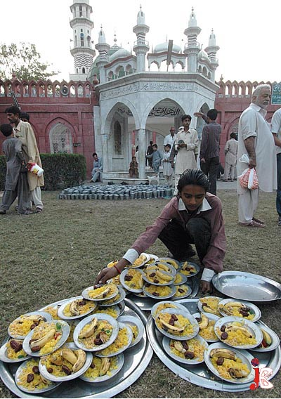 September 16: Muslims distribute food for Iftar outside a local mosque in Lahore.