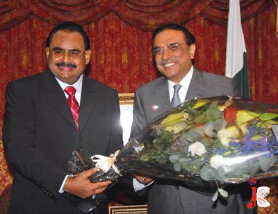 August 28: MQM Quaid Altaf Hussain presenting flower bouquet to President Asif Ali Zardari at London