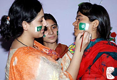 August 12: A girl is painting national flag on the face of another girl