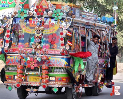 October 02: A passenger bus is decorated with stickers and other decoration items which prevents the driver from having a complete view of the road, thus increasing a possibility of a fatal traffic accident, in Peshawar.