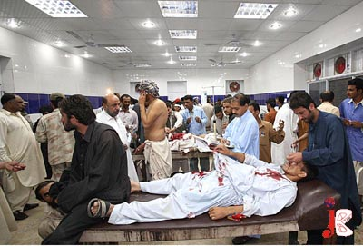 September 05:  Paramedical workers treat the injured persons at Civil Hospital after a hand grenade attack on City Police Station. 3 policemen were killed and 20 injured in the incident