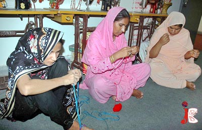October 01: Blind women showing their skills of knitting sweaters at Blinds Centre in Multan
