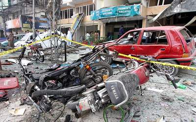 September 26: A view of the carnage at the site of a blast on Mall Road in Saddar Area, Peshawar. At least 10 people have been killed in the explosion.