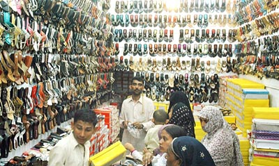 August 31: Women buy shoes from a shop as the preparations for Eid-ul-Fitr have started in Multan