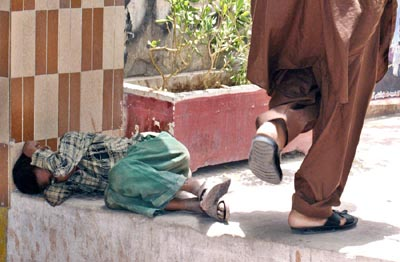 July, 03: A begger child sleeps on footpath, have our leaders ever think about this?
