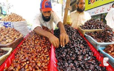 August 18: A man arranges the most favourite item of Ramadan dates on his roadside stall