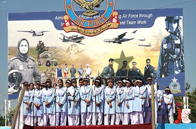 September 06: Schoolchildren present national songs during a ceremony to celebrate National Defence day at PAF Base, Chaklala