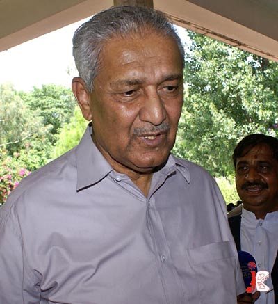 August 28: Father of Pakistan's nuclear program Dr Abdul Qadeer Khan speaks to the journalists on the front door of his house in Islamabad. Lahore High Court has ordered the government to remove any remaining restrictions on him following his release from house arrest.