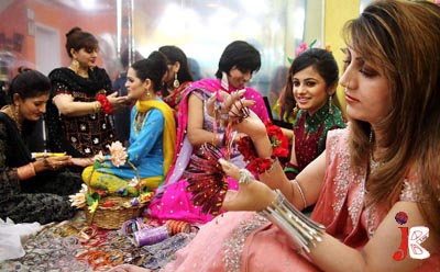 September 19 :  Pakistani girls prepare themselves for Eid at a local beauty parlour in Islamabad