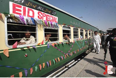 September 18: Passengers wait for the departure of eid special train from Quetta to Peshawar, at Quetta Railway Station. A large number of people return to their native cities to celebrate eid with their loved ones