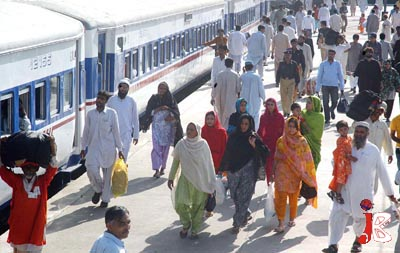 September 18:People board a special eid train at Cant Station, to return to their native city to celebrate eid with their loved ones