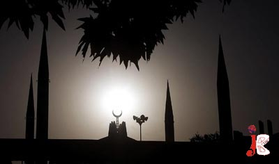 September 07: A beautiful view of the sun setting behind Faisal Mosque in Islamabad