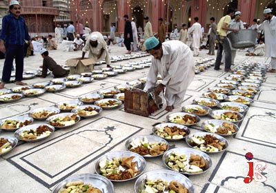 August 23: Muslims arrange food items for Iftar at New Memon Mosque on the 1st day of Ramadan