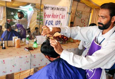 July, 19: Free hair cut service of IDPs from a barber of Peshawar