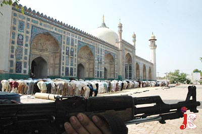 September 04: A policeman stands alert as worshippers offer Friday prayers in Multan