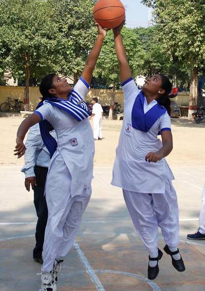 September 26: Students play basket ball during a sports camp at a local school in Model Town