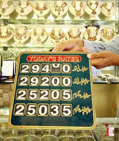September 03: A Pakistani jeweler changes the price tag at the rate list of his shop as the gold prices reached the highest level in the history of Pakistan