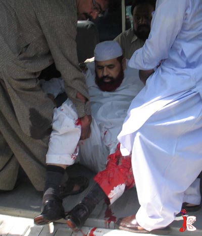 September 02: Pakistani rescue workers bring Federal Minister for Religious Affairs Hamid Saeed Kazmi in the hospital, after some unknown miscreants opened fire on his vehicle near Melody Market. Driver of the vehicle Muhammad Younis was killed in the incident