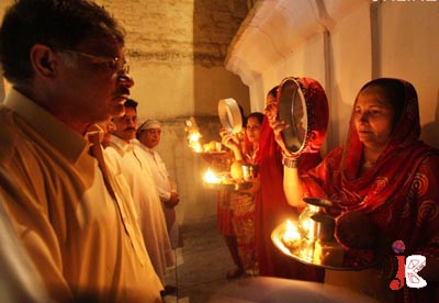 October 07: Hindu women look at their better halves during a religious festival at a local temple in Rawalpindi.