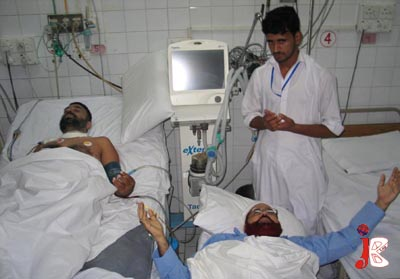 September 05: Federal Minister for Religious Affairs Hamid Saeed Kazmi prays for the health of his guard who sustained critical injuries during an assassination attempt on the religious affairs minister