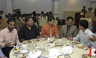 September 05: Federal Minister for Minorities Affairs Shahbaz Bhatti shares a light moment with the journalists during a reception hosted by him at a local hotel