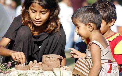 September 10: Young children prepare clay items at their protest camp outside National Press Club. The residents of Jhang are holding a protest camp for the last 30 days against the occupation of land mafia on their plot in Jhang
