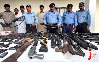 September 19: Pakistani policemen show the illegal weapons recovered during a raid on the office of a security company Inter Risk. The company provides security to US citizens and US Embassy in the capital