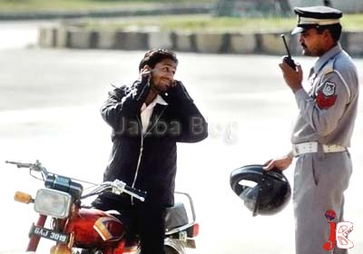 August 16: A man who was riding his bike without helmet saying sorry to traffic warden in front of parliament house Islamabad. (File Picture)