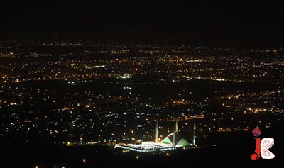 September 18: A beautifully illuminated view of Faisal Mosque seen from the road leading to Pir Sohawa