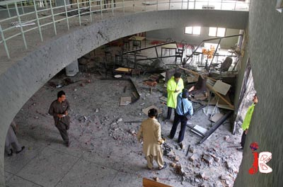 October 08: Pakistani policemen inspect the site after two blasts at International Islamic University. Twin suicide blasts rocked the new campus of Islamic University, Islamabad killing at least five persons and injuring 13 others.