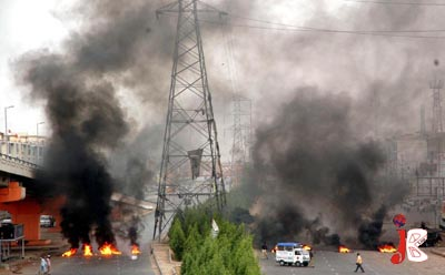 August 17: Thick smoke wafting upward at Main Nagan Chowrangi Road where angry mobs burnt tyres to block the road in protest against killing of head of outlawed Sipah-e-Sahaba Pakistan, Alama Ali Sher Haidri, who was gunned down in District Khairpur in wee hours of Monday