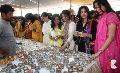 October 15: Students take keen interest in the items displayed during a ceremony to celebrate Students' Week at Jinnah University.