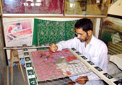 September 28: A craftsman is busy in embroidery work at his shop in Multan