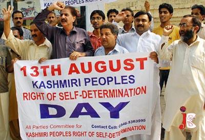 August 13: Activists of Jammu & Kashmir Liberation Front shout slogans against Indian occupation on Kashmir, during a demonstration at Shimla Pahari Chowk