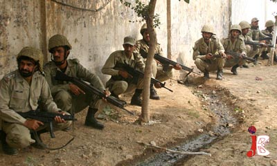 October 15: Pakistan army soldiers take position after the militants' attack on Munawan Police Training Center.