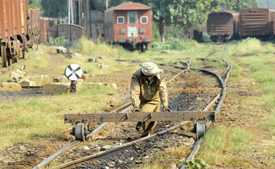 October 09: A labourer is busy in his work on the railway track near Lahore Railway Station