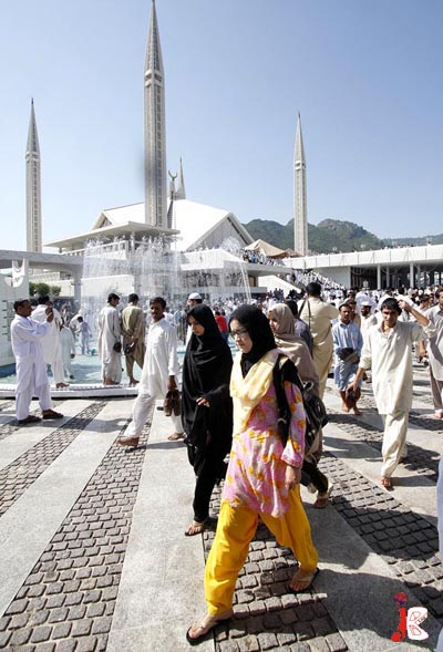 September 18: Pakistani Muslims return after offering Friday prayers at Faisal Mosque on the eve of Jumma-tul-Wida
