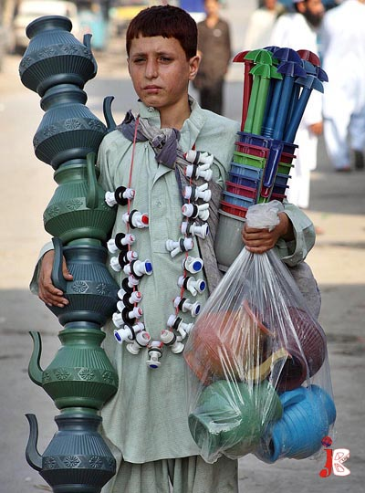 October 02: A Pakistani boy selling plastic items to earn some living for his family at Gulbahar Chowk.