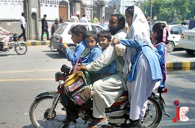 September 10: A man rides his heavily overloaded motorcycle which may cause any severe accident in the provincial capital