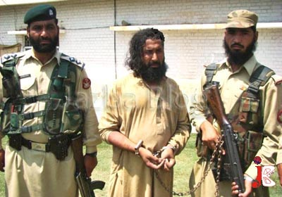 August 18: Pakistani paramilitary soldiers escorting arrested Taliban spokesman Maulvi Omar  at a paramilitary compound in the northwest tribal district of Mohmand. Pakistani security forces have captured top Taliban spokesman Maulvi Omar, weeks after the reported death of his boss, feared warlord Baitullah Mehsud, military officials said