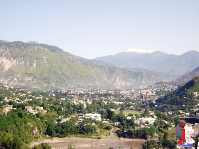 September 16: The view of Muzaffarabad city overlook by Makra Mountain which recicive first snow fall on tuesday night