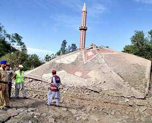 The roof of the Mosque collapses after attack
