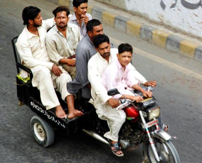 July, 15: A motercycle Rikshaw full of people at Shahrah-e-Pakistan Karachi after citizens faced problems due to strike called by the transporters against increase in fuel prices