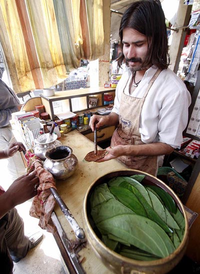 September 28: A man prepares paan at his shop in Islamabad. People of the subcontinent have been great fond of eating Paan since several centuries despite its severe ill effects. The materials used in the preparation of Paan are mostly imported from India.