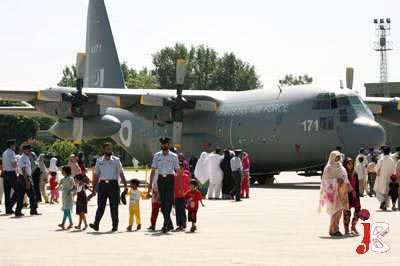 September 06: Women look at the planes displayed during a ceremony to celebrate National Defence day at PAF Base, Chaklala