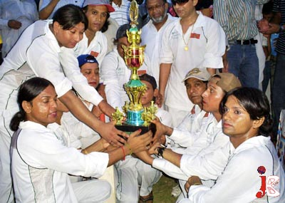 August 16: A group photo of winning eunuch cricket team with the trophy, this match is played first time in Pakistan at Jinnah Municipal Stadium in Sukkur