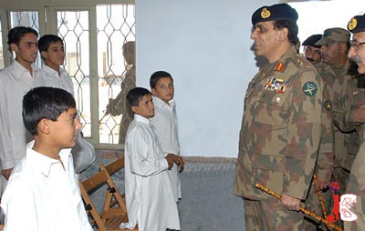 September 04: Pakistani Chief of Army Staff, General Ashfaq Parvez Kayani meeting with children during his visit to Rehabilitation Facility Sabaoon (morning light) which has been established in Barikot for psychological treatment of the children, who were forcibly taken away by the terrorists, on Friday